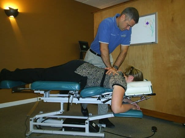 Chiropractor Oneida NY Peter Lombardi and patient
